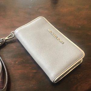 Michael Kors silver clutch wallet wristlet